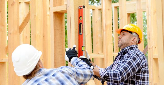 general contractor with framing level
